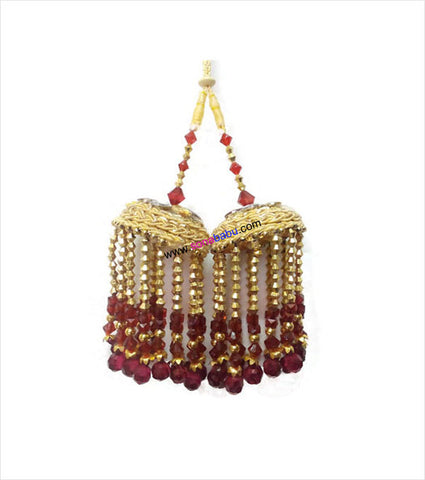 Tinkling bridal kalire in maroon golden look