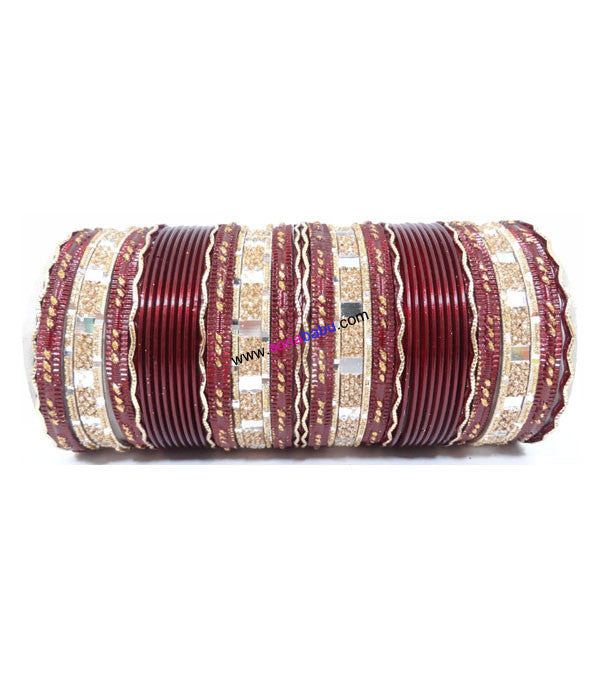 Maroon colored metal bangle with zigzag golden work
