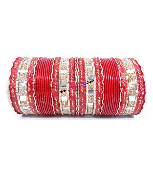 Red colored metal bangle with zigzag golden work
