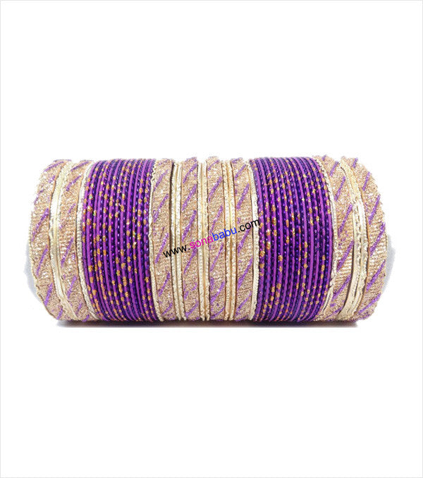 Purple and golden colored metal bangle with full work