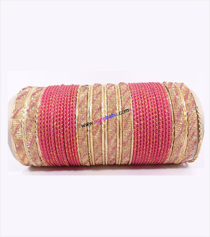 Pink and golden colored metal bangleswith full work