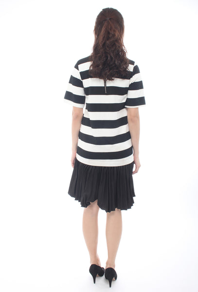 Dress with pleated hem
