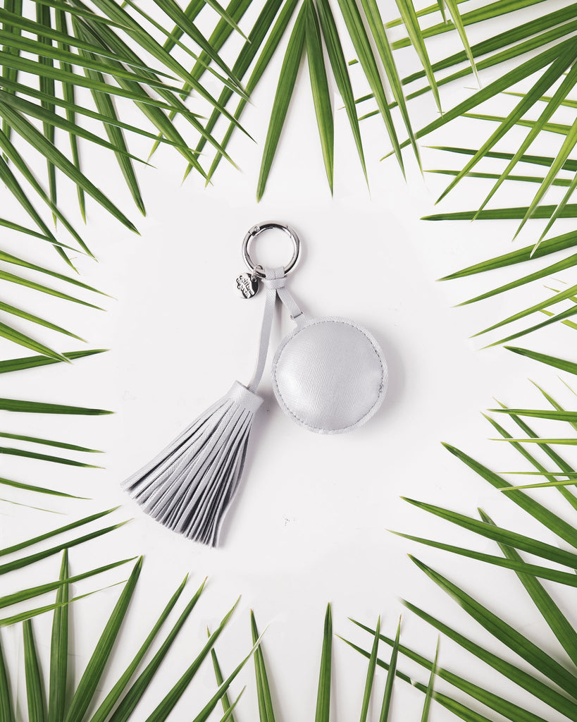 A GIFT FROM THE GODS SILVER ROUND TASSEL KEYRING