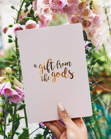 A GIFT FROM THE GODS GOLD SLOGAN PINK A5 NOTEBOOK