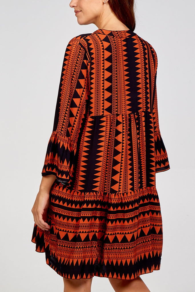 RUST AZTEC PRINT SMOCK DRESS