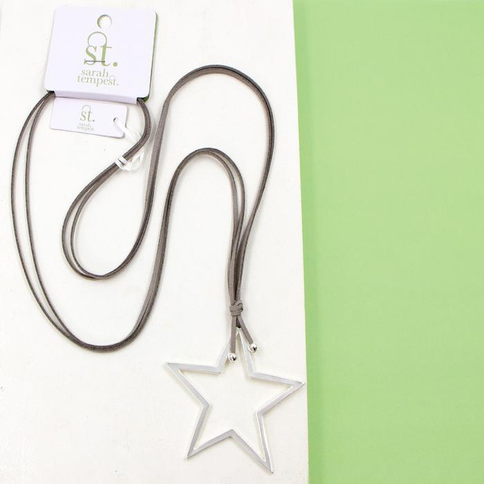 OPEN STAR PENDANT ON LONG FAUX SUEDE NECKLACE