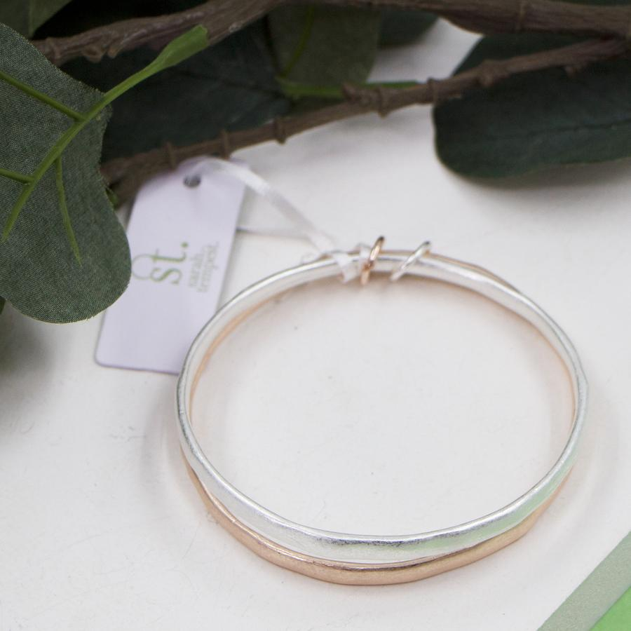 WORN SILVER AND ROSEGOLD BANGLES WITH LINKS