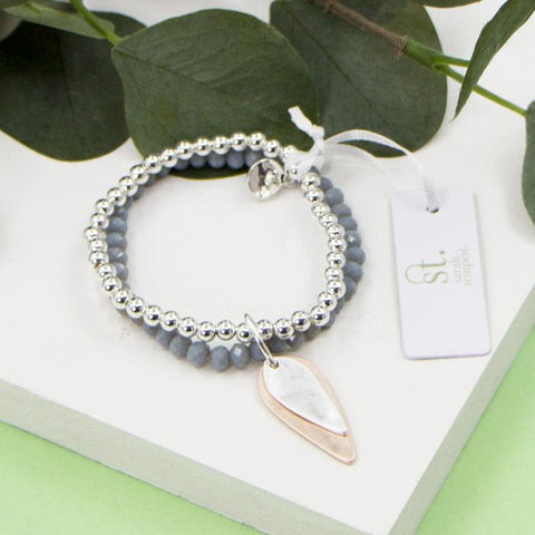 GREY BEADED STRECHY BRACELET WITH OVAL SHAPED CHARM