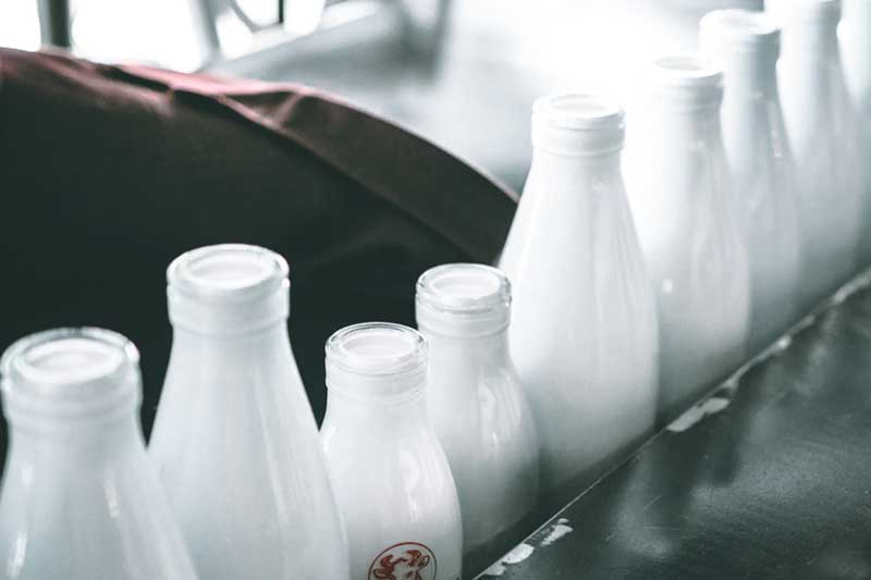 close-up shoot of glass bottled dairy products with blur background