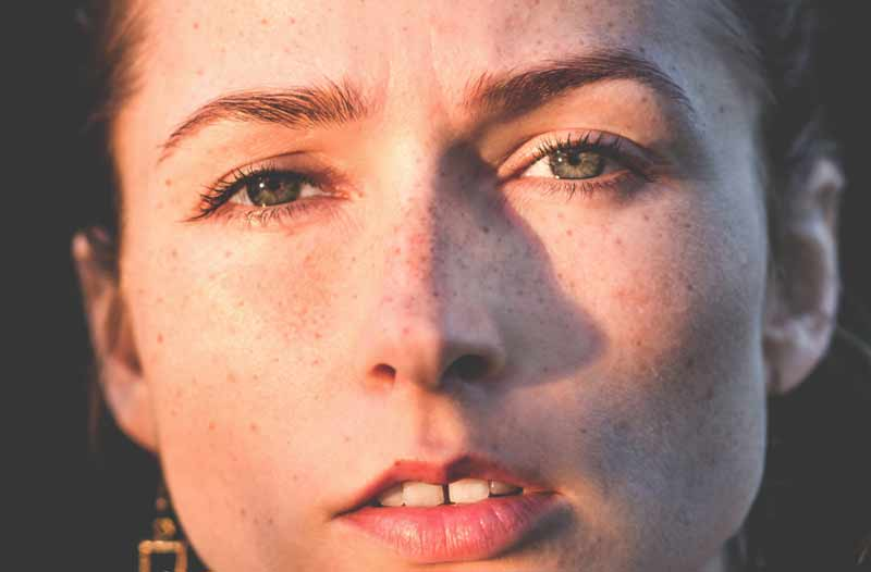 close up of beautiful woman face with worried expression