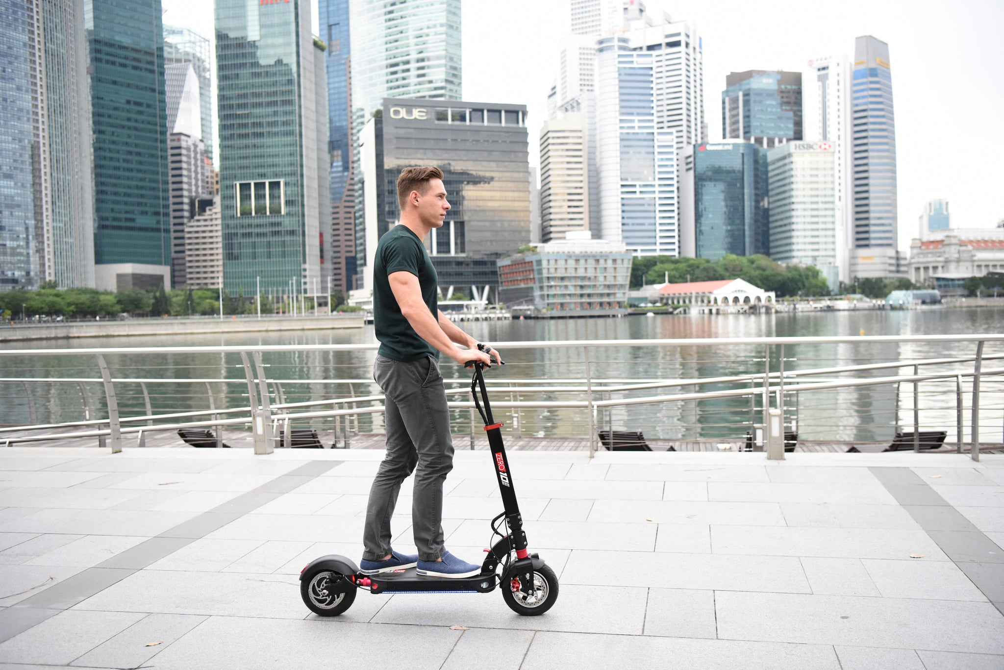 Guy on ZERO 10 scooter in business district