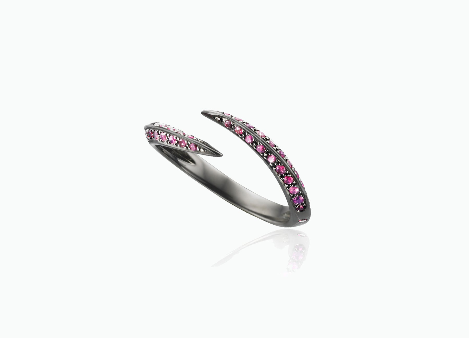 BLACK STAR SINGLE CLAW RING WITH RUBIES