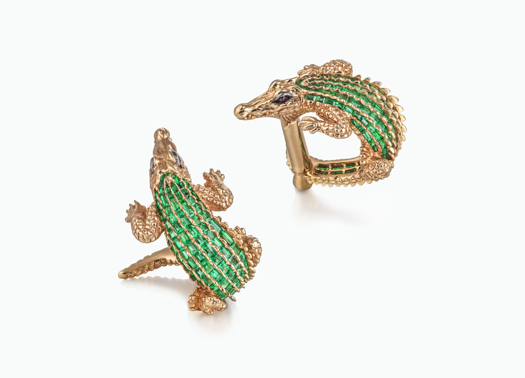 ONE OF A KIND CROCODILE CUFFLINKS IN 18k Yellow gold set with 4 carats of baguette cut emeralds and two rubies