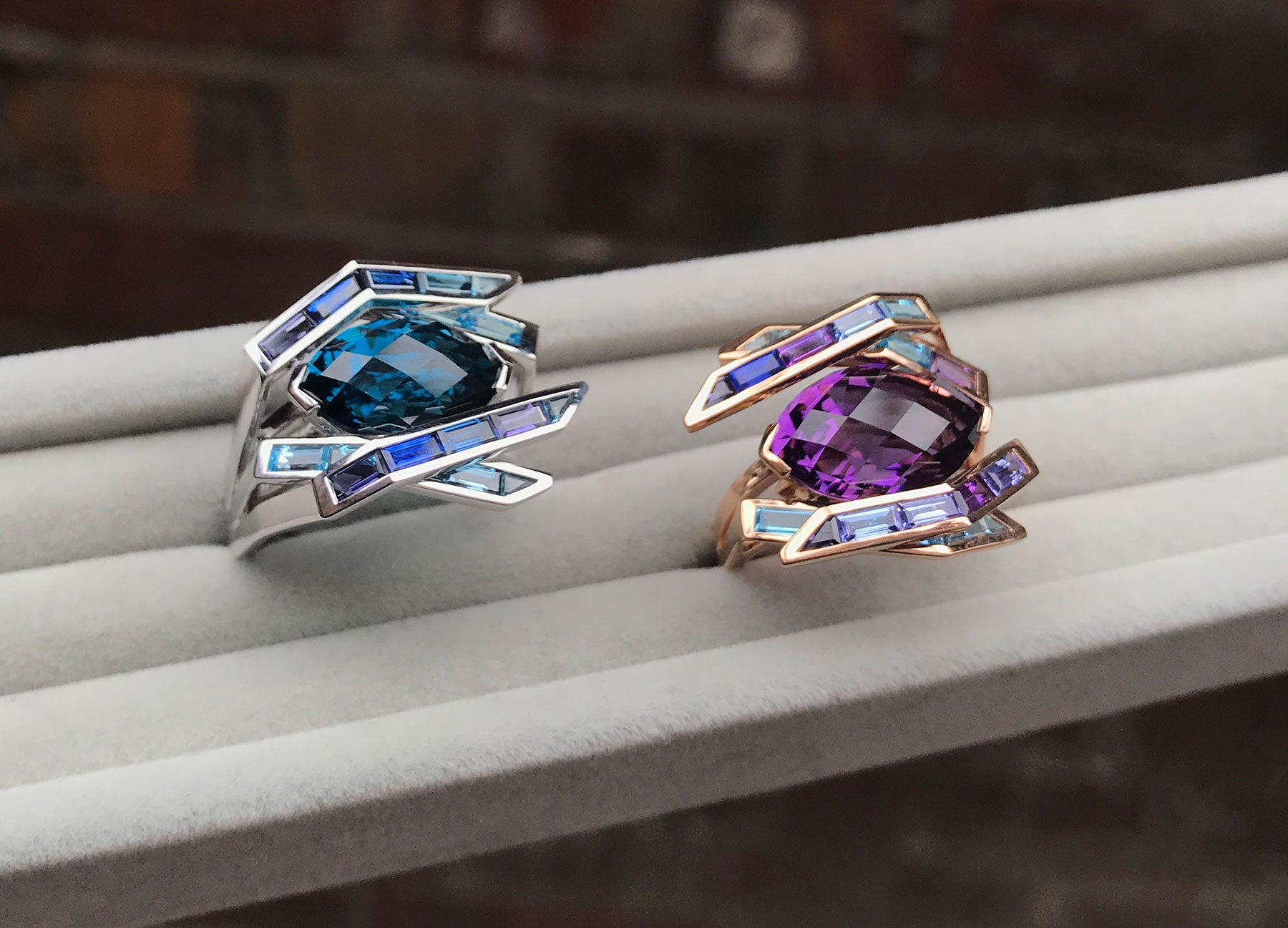 Electric Night Amethyst and Blue Topaz cocktail rings by Tomasz Donocik side by side