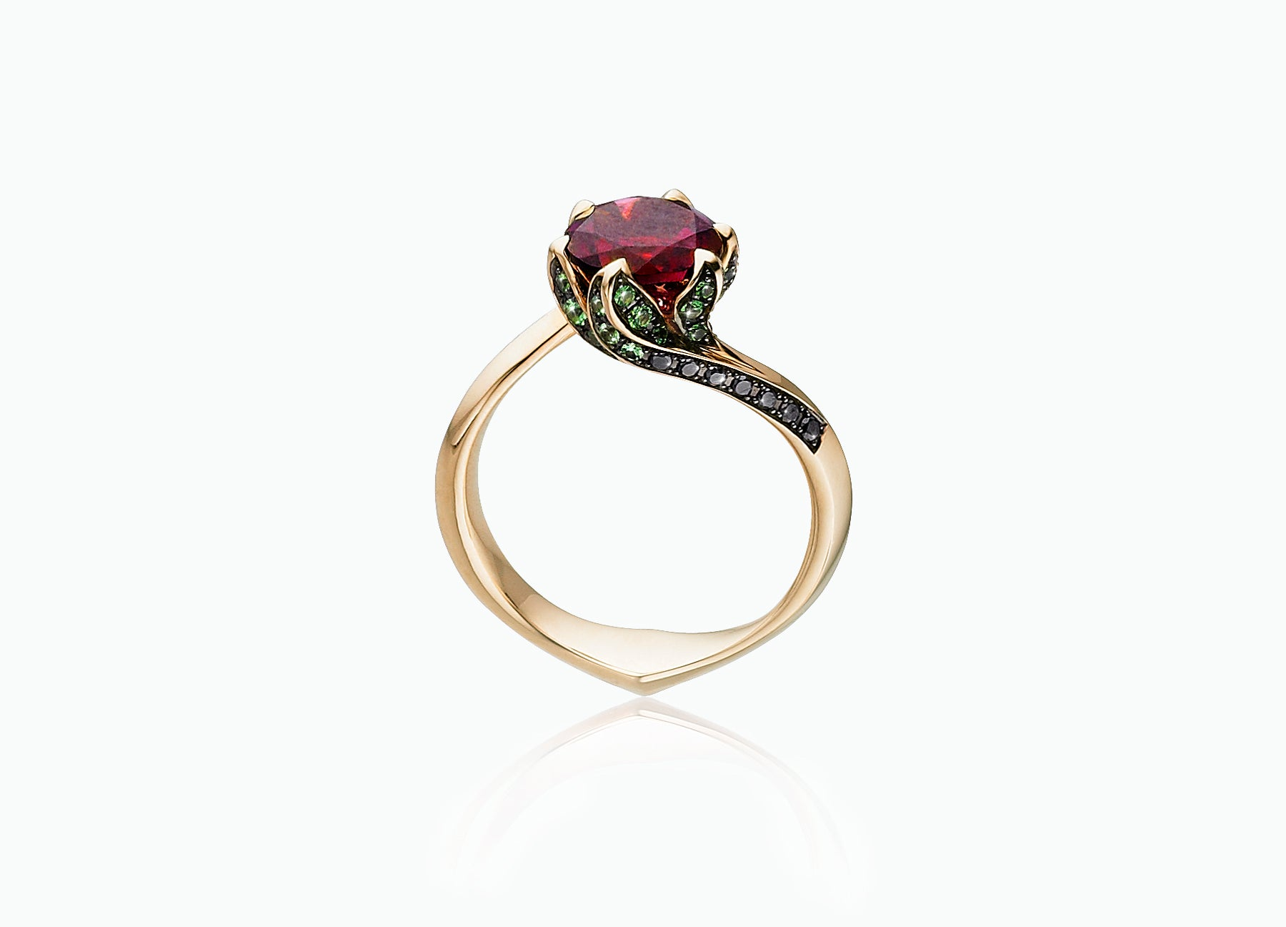 Lily Pad engagement ring in 18K yellow gold set with a rubellite tourmaline centre stone side view