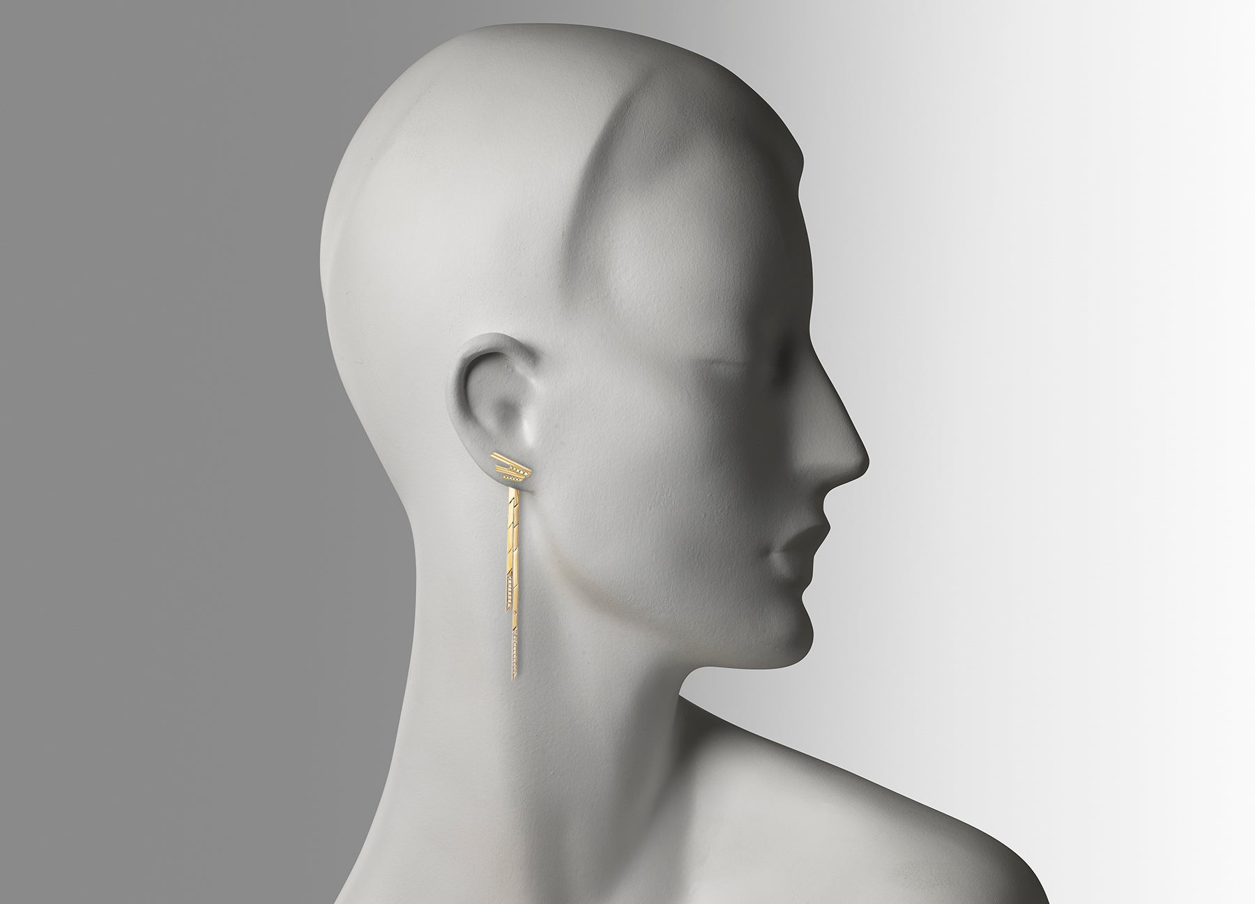Mini Stellar Stud earrings with detachable drops in 18K yellow gold with white diamonds by Tomasz Donocik worn on mannequin