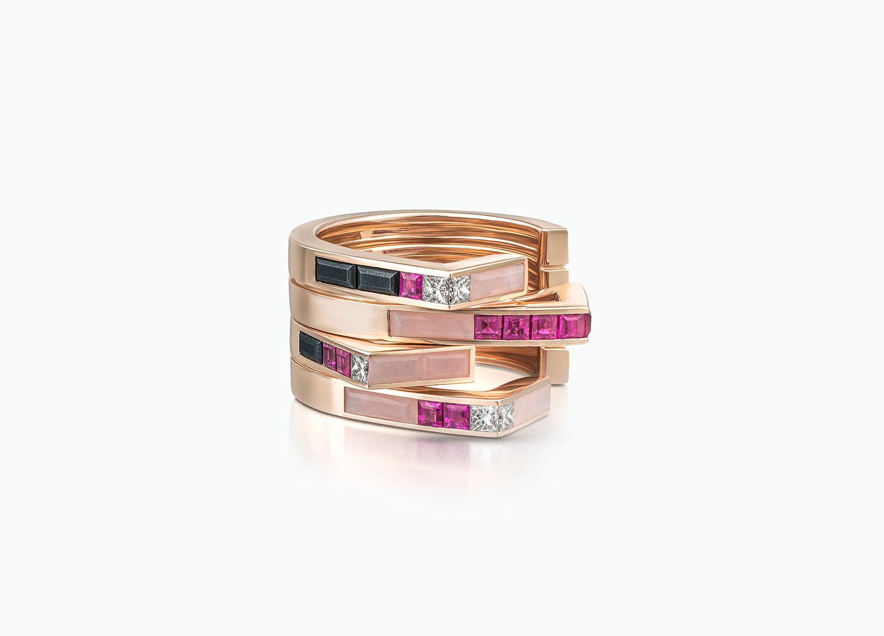 Stellar Pair of Stacking rings in 18K rose gold set with rubies and diamonds and pink opal by Tomasz Donocik Seen together
