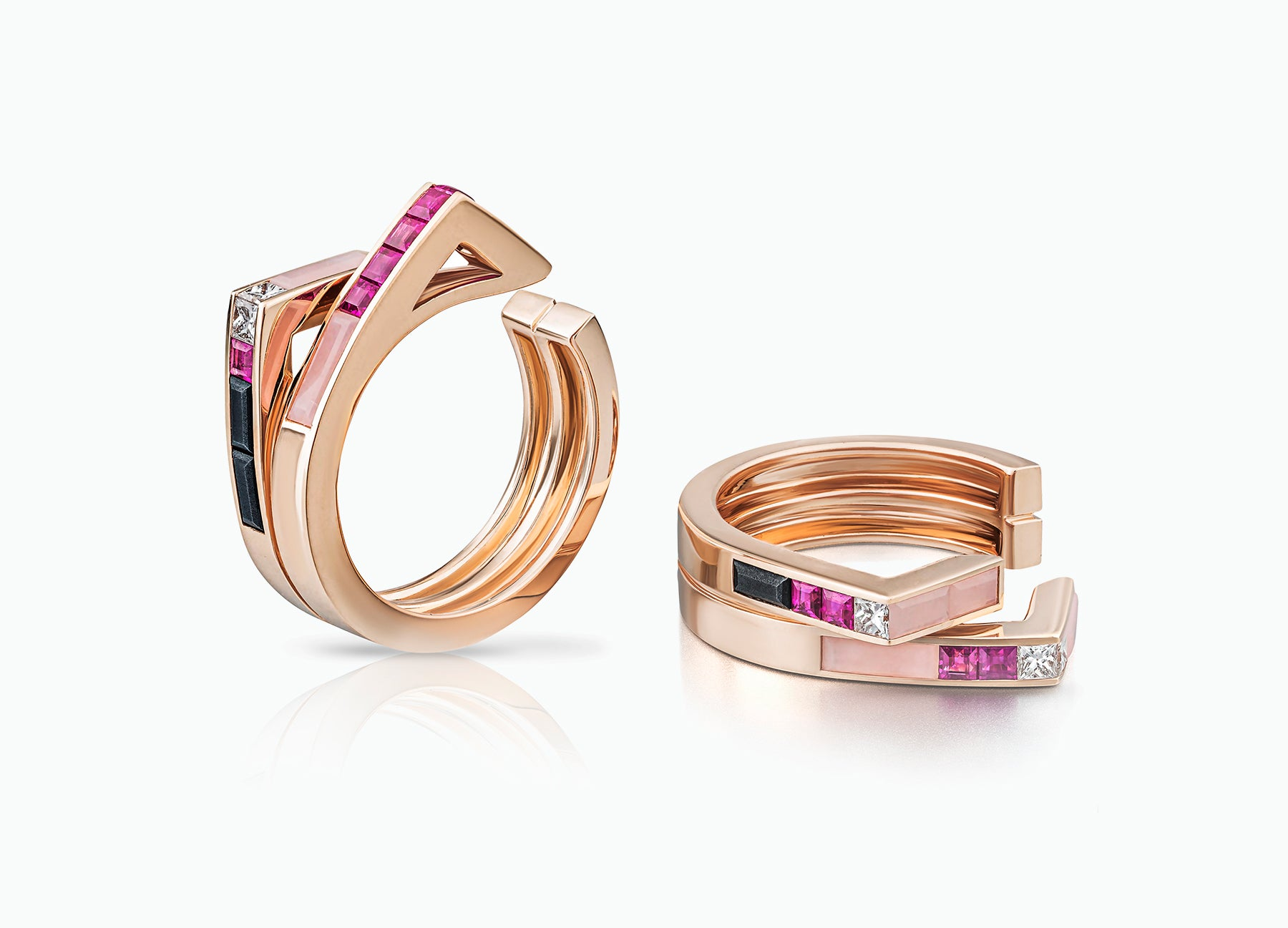 Stellar Pair of Stacking rings in 18K rose gold set with rubies and diamonds and pink opal by Tomasz Donocik Seen apart