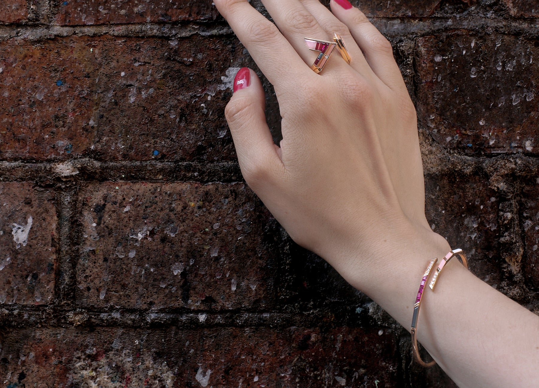 Ruby diamond and pink opal bangle in 18K rose gold by Tomasz Donocik worn view 2