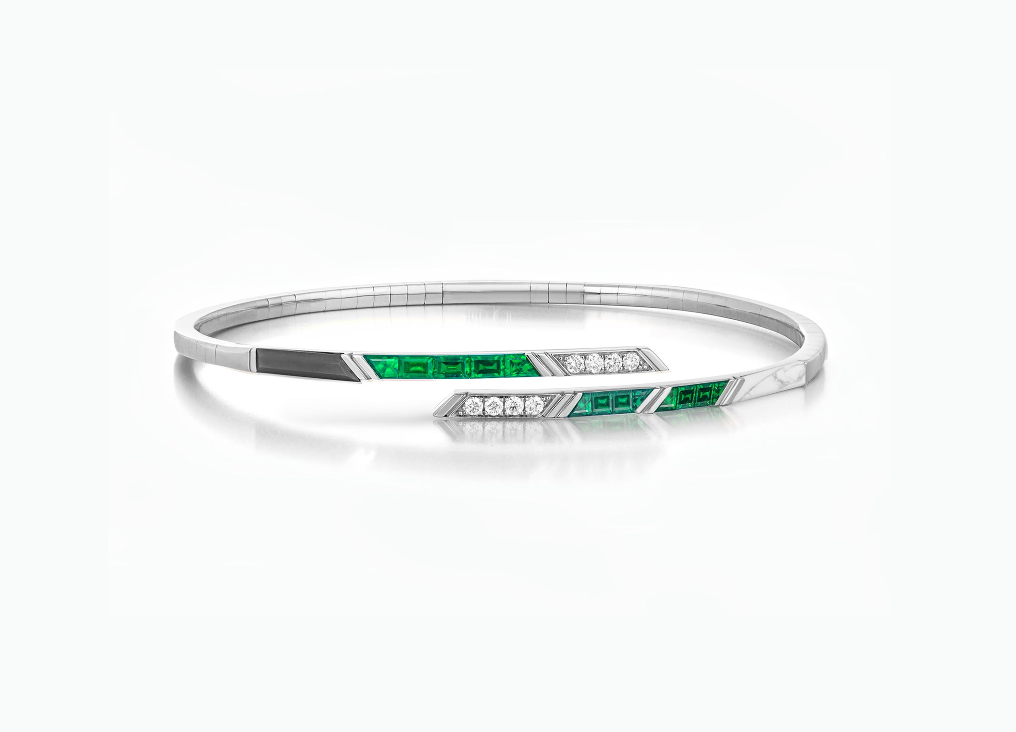 Art Deco bangle in 18K white gold with diamonds, emeralds and tsavorite garnets by Tomasz Donocik