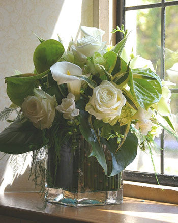ivory Roses, Lisianthus, lime green Anthurium or Blooms with other seasonal flower and foliage.