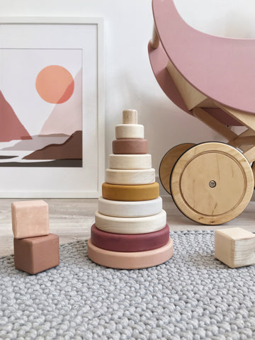 """Wooden toy - Sabo Stacking Pyramid in Pink A classic conical stacking tower in a beautiful terracotta and spruce palette. The graduated stacking rings create a simple first """"puzzle"""" for toddlers and preschoolers"""