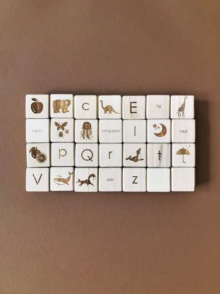 Sabo Concept english alphabet blocks in natural wood