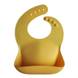 mushie Mushie Silicone Bibs in Yellow