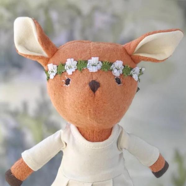 Phoebe Fawn in natural tunic and flower crown portrait