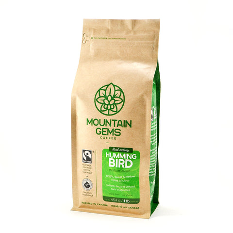 a 1 lb bag of Mountain Gems Hummingbird Fairtrade Organic Coffee