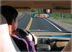 rear view mirror being used in car