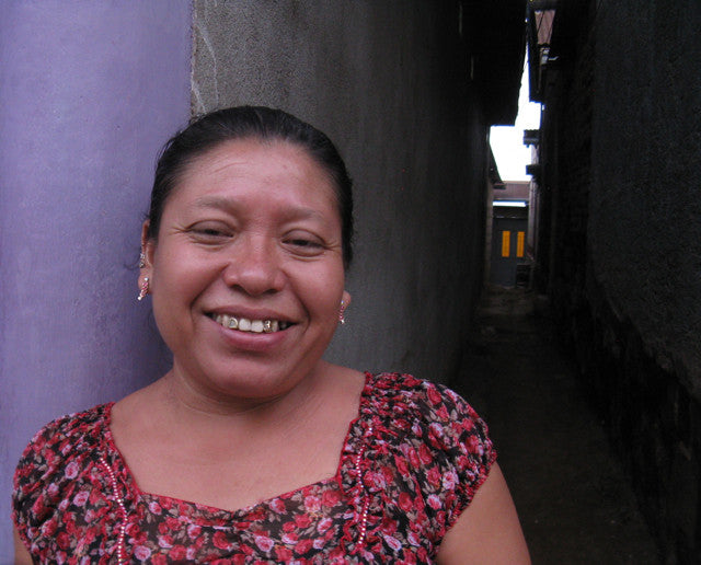 Master weaver Sonia Antonieta Cholotío in the alley by her house headshot for MayaWeavings