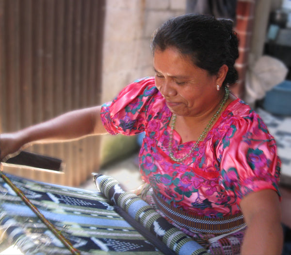 Master weaver María Florinda Pérez working at her backstrap loom