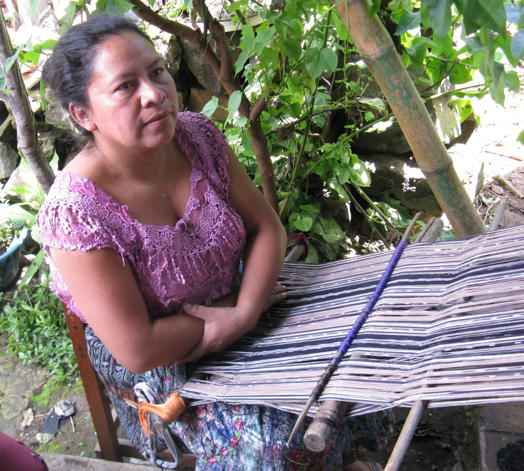 Master Backstrap Loom Weaver María Carmen Pérez pausing to discuss the natural dye plants she uses