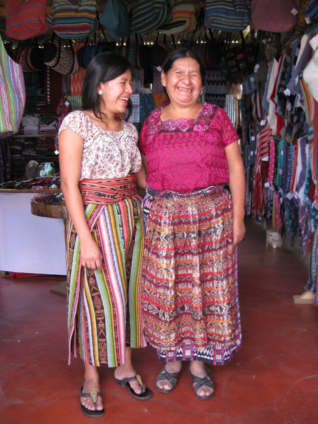Master Backstrap Loom Weaver Natalia Mendoza at the cooperative laughing with her daughter