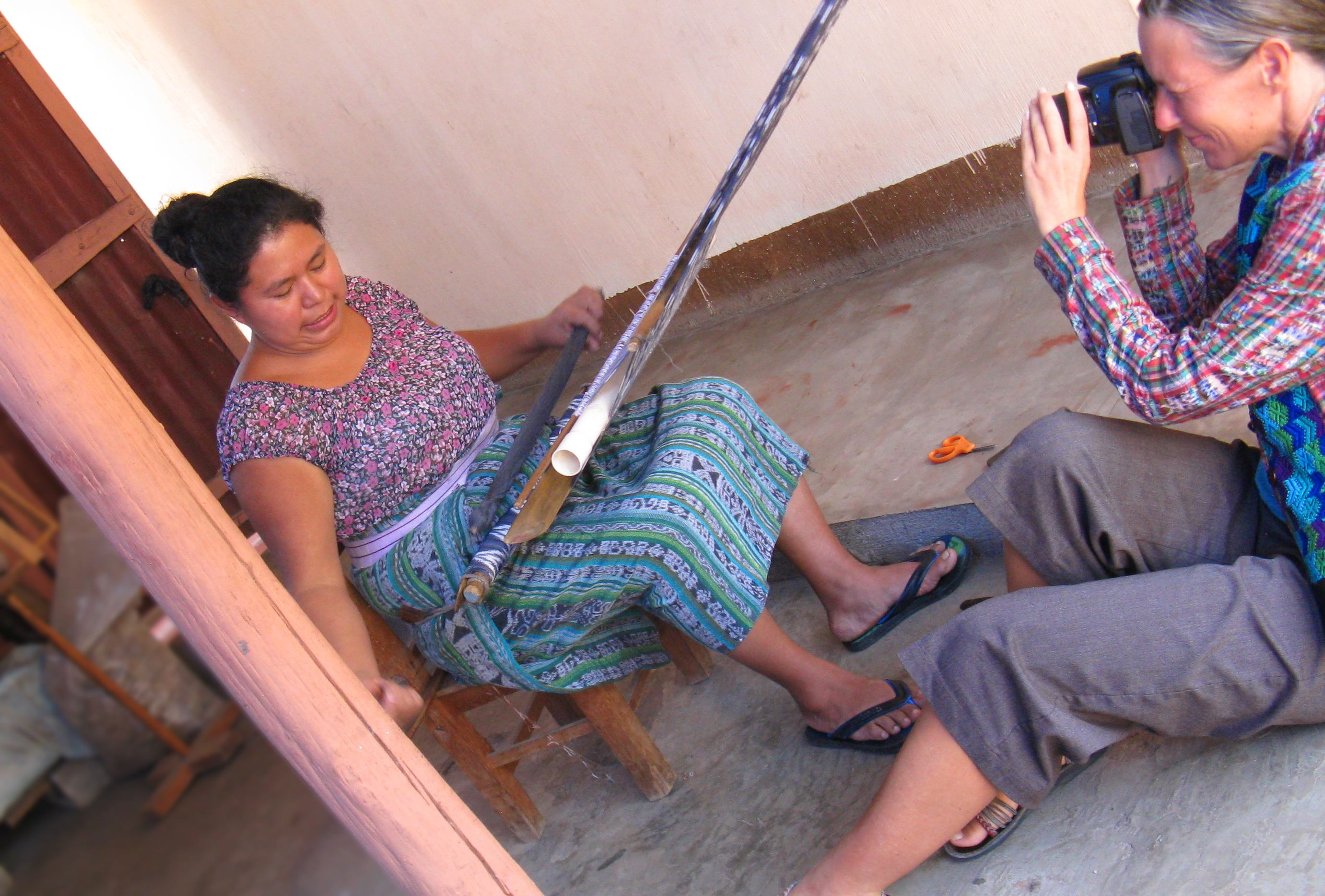 Mayan Master Backstrap Loom Weaver Isabel Pérez Mendoza at her loom and Emma Goude Documentary film maker shooting photos