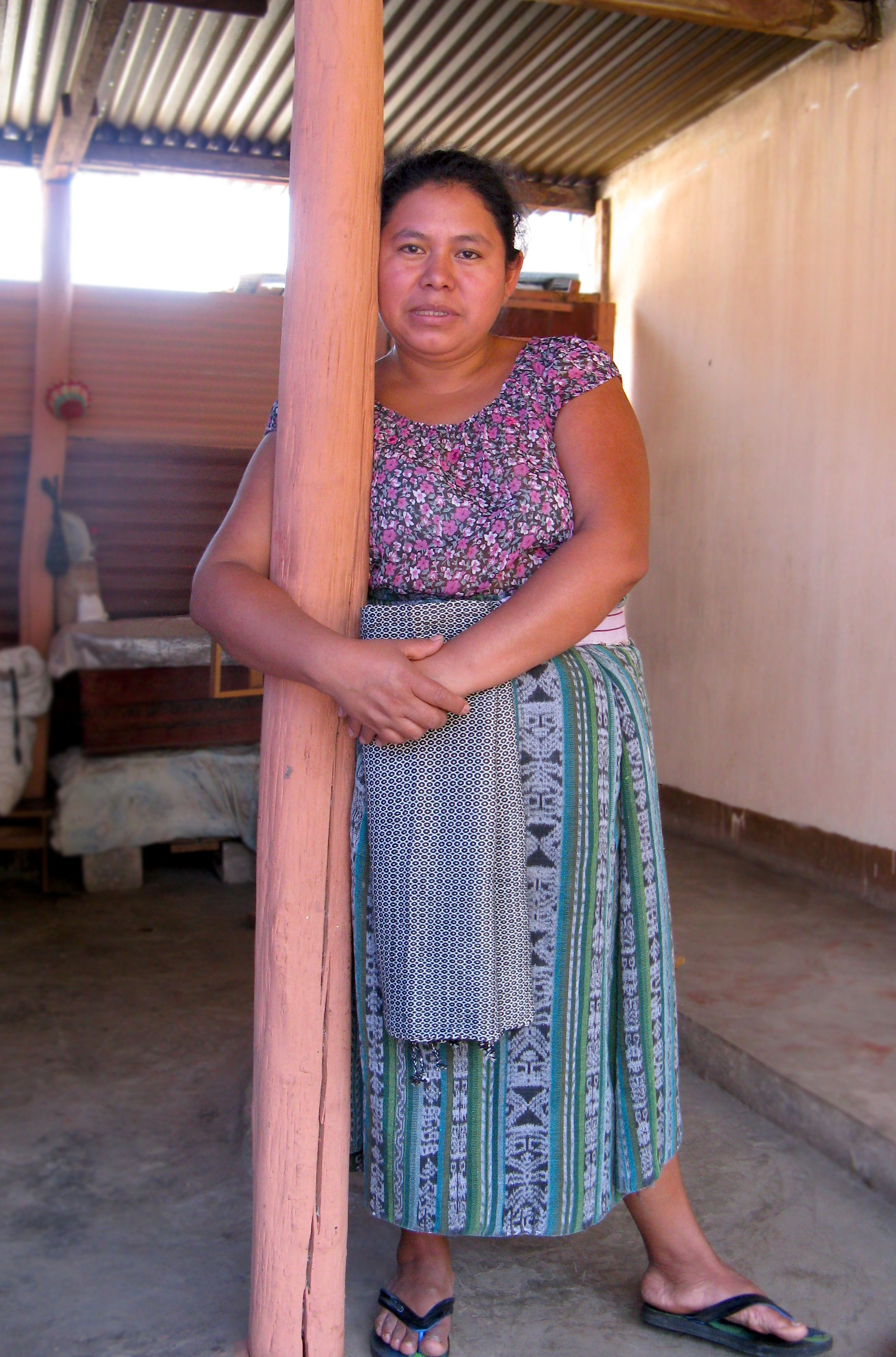 Mayan Master Backstrap Loom Weaver & Dyer Isabel Pérez Mendoza at her home leaning against a center pole