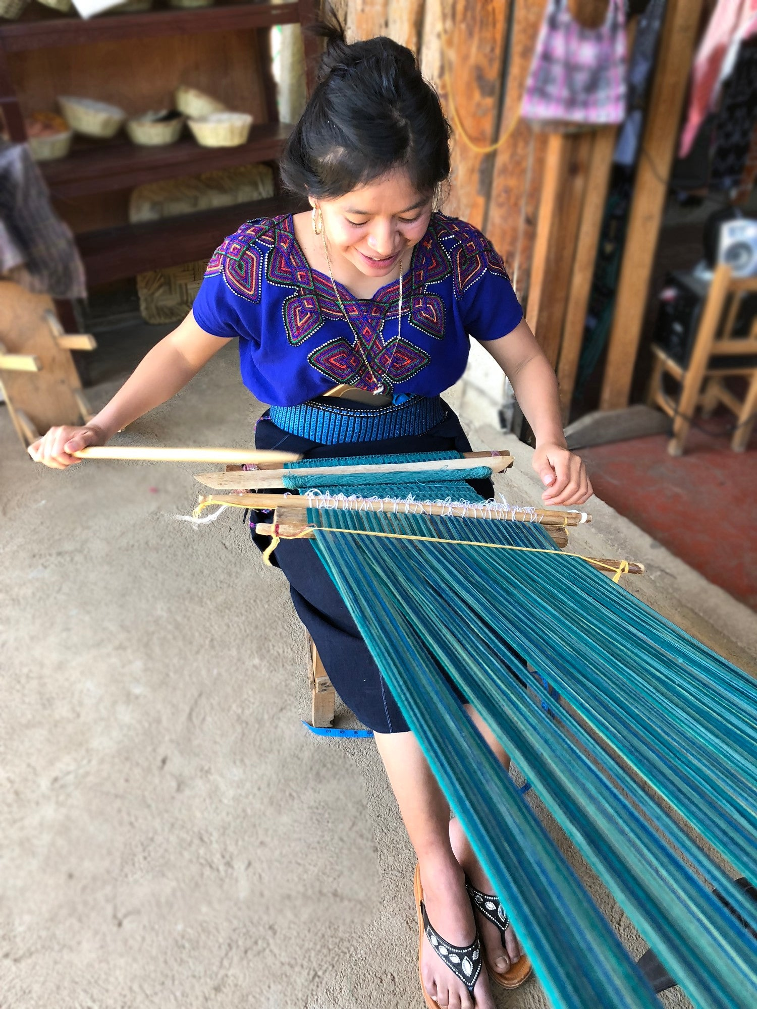 Mayan backstrap loom weaver Amelia Vásquez at her loom at the Quetzalli women's weaving cooperative San Juan La Laguna Guatemala