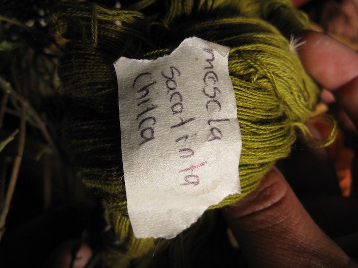 sacatinta combined with chilca results in a deep olive green shown on this ball of cotton thread
