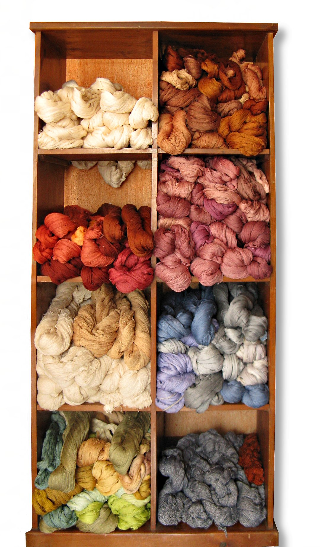 Display shelf bulging with all shades of naturally dyed cotton hanks ready for backstrap loom weaving