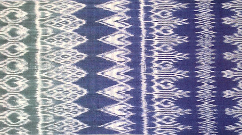 example of a green fading to blue shawl with eight identical parallel panels of ikat (jaspe)