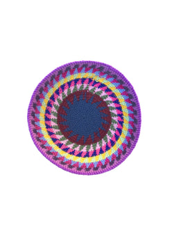 Small hand crocheted bowl from Guatemala. Lavender rim with blue center star. Overhead view