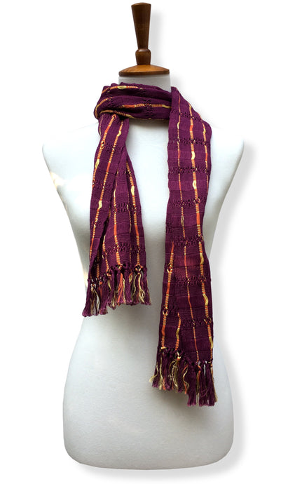 Handwoven Dark burgundy cotton scarf with gold/orange accents. Backstrap loom made Guatemalan textile, neck wrap view