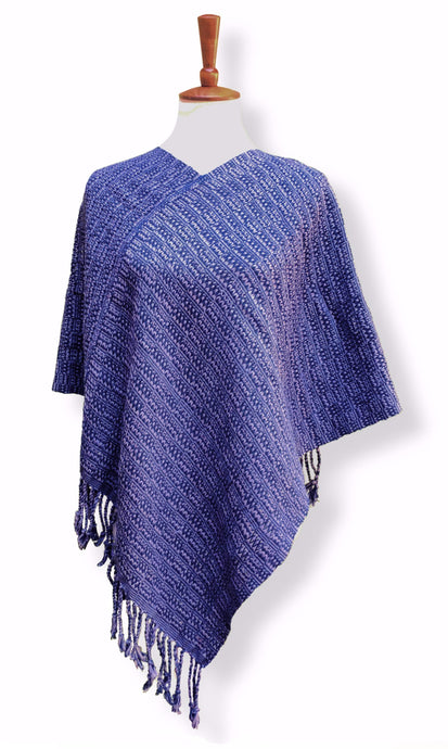 Backstrap loom woven poncho in offset twisty weave of purple hyacinth and blue grape. Guatemalan textile. Front view.
