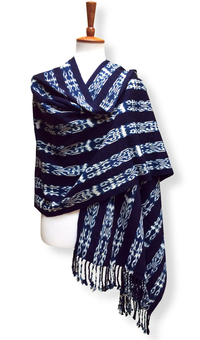 Handwoven rebozo shawl with indigo ikat. Backstrap Loom woven in heavy cotton with natural dyes. Deep dark eggplant and denimy blue. Guatemalan textile. front cross over view