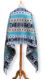 Handwoven Rebozo shawl with indigo ikat panels. Shades of aqua and sky blue with tan and white.  Heavy Cotton Backstrap Loom Woven Guatemalan textile. Back view