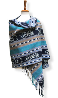 Handwoven Rebozo shawl with indigo ikat panels. Shades of aqua and sky blue with tan and white.  Heavy Cotton Backstrap Loom Woven Guatemalan textile. Front wrap view