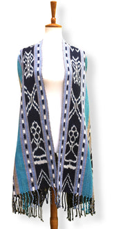 Handwoven Rebozo shawl with indigo ikat panels. Shades of aqua and sky blue with tan and white.  Heavy Cotton Backstrap Loom Woven Guatemalan textile. Front loose view