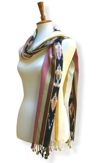 Handwoven cotton scarf or shawl with multi-colored hand dyed ikat. Backstrap loom made Guatemalan textile, simple wrap view