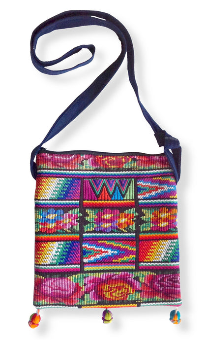 Shoulder bag sewn from a vintage backstrap loom woven huipil with intricate brocade designs of flowers and ziggy zaggy Maya symbols. Multi-colored.